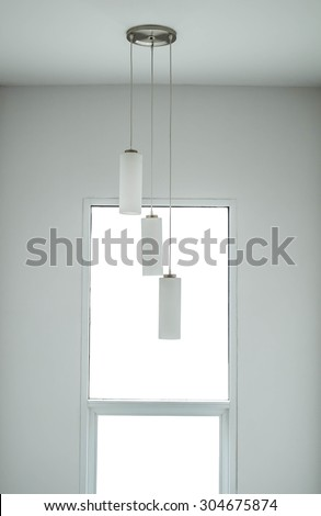modern interior minimal white space, with modern window and lamps - stock photo