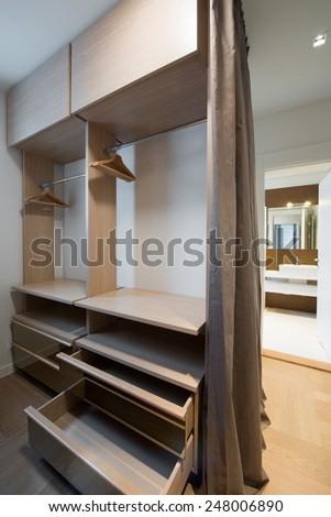 modern interior of bright wooden wardrobe - stock photo