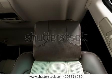 Modern interior of car. Leather headrest. - stock photo