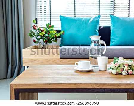 Modern interior of Living room with coffee table and sofa background - stock photo