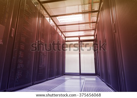 Modern interior of server room, Super Computer, Data center with abstract color effect. - stock photo
