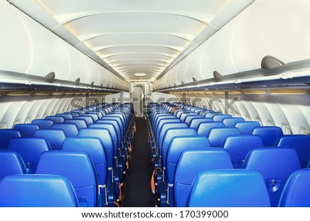 modern interior of the airliner - stock photo