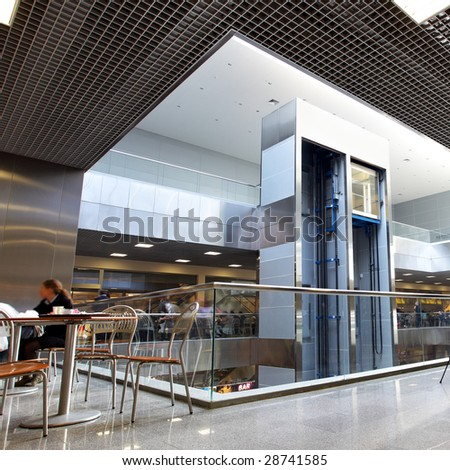 Modern interior of trade center with lift - stock photo