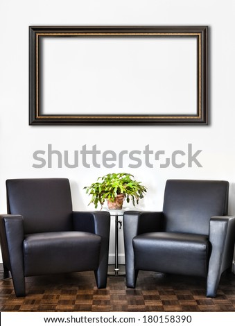 Modern Interior Room and white wall and big empty Painting Frame with space for your text. Two luxurious couch and glass table with accessories of your choice. - stock photo