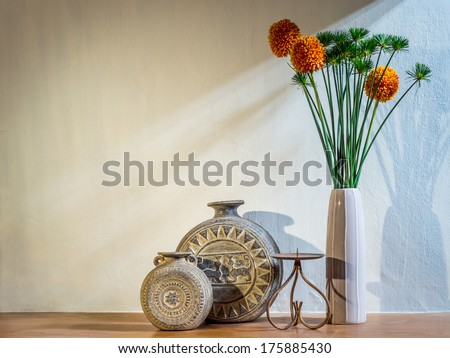 Modern interior room  with artificial flowers in ceramic vase - stock photo