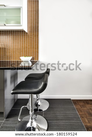 Modern Interior Room with beautiful Counter and Stools. Flat Blank Wall for your text, painting, logo or whatever you need to be there. - stock photo