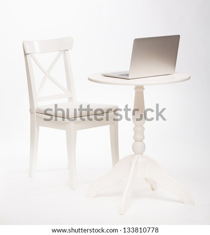 Modern interior white chair and table with laptop - stock photo