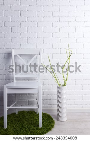 Modern interior with chair on white brick wall background - stock photo