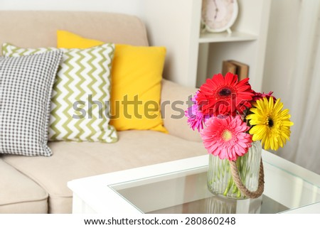Modern interior with comfortable sofa in room - stock photo