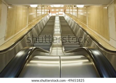 Modern interior with escalator. - stock photo