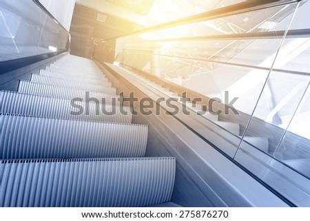 Modern interior with escalator close-up - stock photo