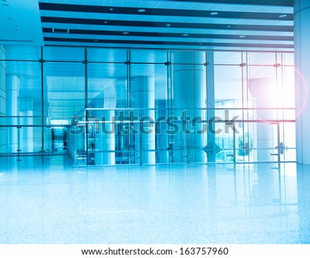 modern interior with glass wall in an office building. - stock photo