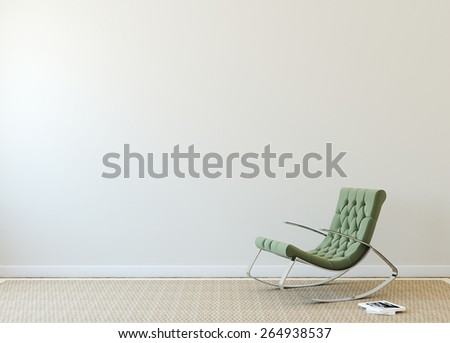Modern interior with green armchair near beige wall.