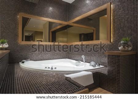 Modern jacuzzi with corner mirror - stock photo