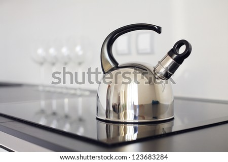 modern kettle on the stove - stock photo