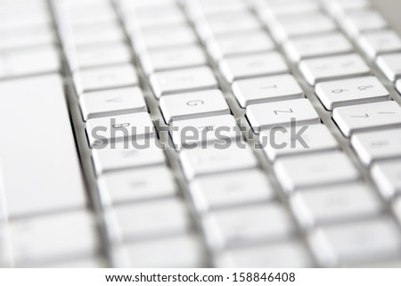 Modern Keyboard shallow depth of field - stock photo