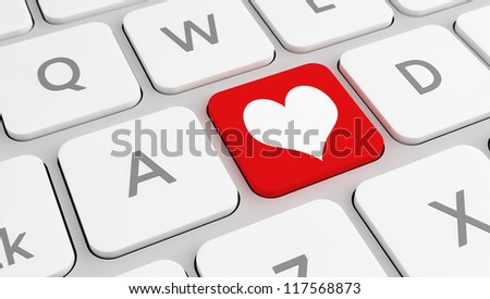 Modern keyboard with a red key with a heart, with a selective focus. Concept for love, favorite, etc.