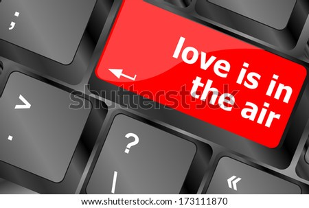 Modern keyboard with love is in the air text