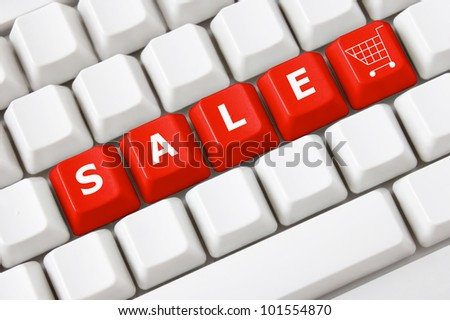 Modern keyboard with text sale on buttons and shopping cart symbol.Concept