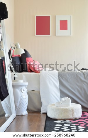 modern kids bedroom with red pillows and shoes at home - stock photo