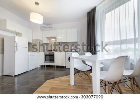 Modern kitchen and open space interior design in white color - stock photo