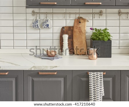 modern kitchen chopping board behind white tile wall interior trend - stock photo