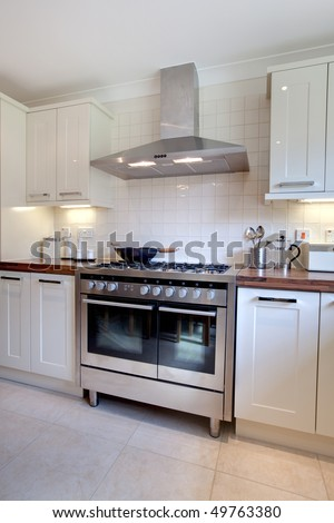 Modern Kitchen Stove cooker hood stock images, royalty-free images & vectors | shutterstock