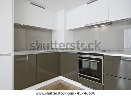 modern kitchen corner unit with granite stone worktop - stock photo
