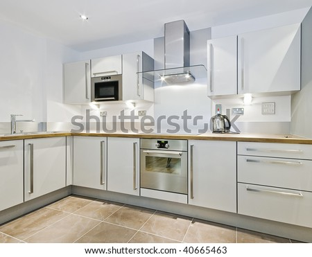 "modern kitchen counter in ""L"" shape with wooden worktop - stock photo"