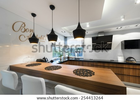 Modern kitchen counter interior design in black and white style - stock photo