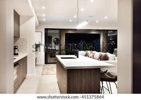 Modern kitchen counter top closeup with a view of patio area from the outside at night - stock photo