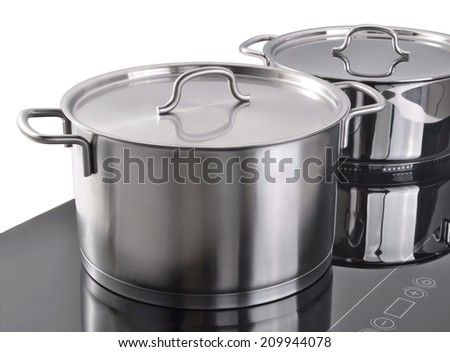 Modern kitchen, Induction cooker and kitchen utensils. - stock photo