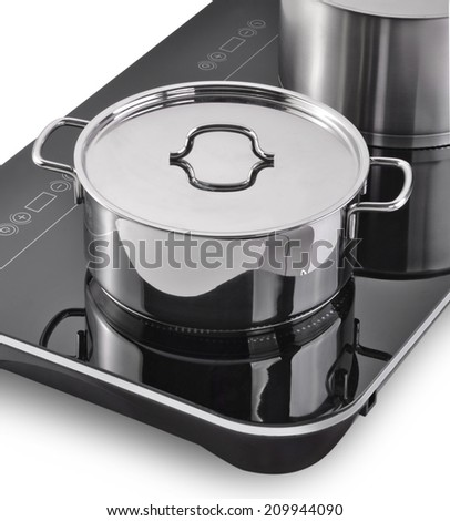 Modern kitchen, Induction cooker and pan - stock photo