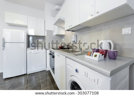 Modern kitchen interior design in white color and scandinavian style - stock photo