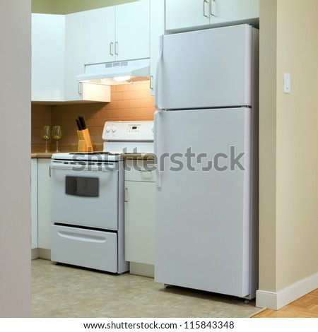 Modern kitchen interior in new home - stock photo