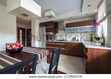 Modern kitchen interior with dinning room - stock photo