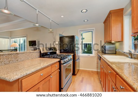 Modern kitchen interior with granite counter tops, Maple kitchen cabinets and stainless steel appliances. Northwest, USA