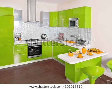 Modern kitchen interior with green decoration - stock photo
