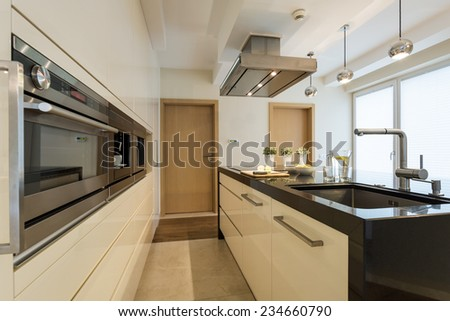 Modern kitchen interior with oven housing unit - stock photo