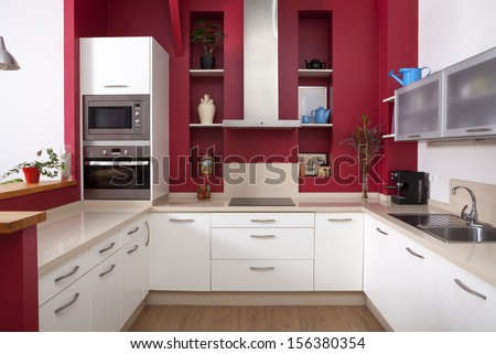 Modern kitchen interior with red walls and white furniture - stock photo