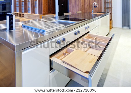 Modern kitchen interior with stainless steel sink and appliances - stock photo