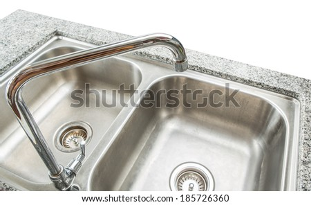 Modern kitchen sink and granite surface counter - stock photo