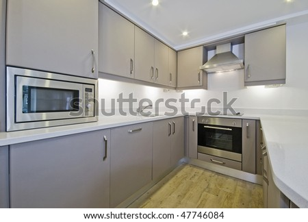 modern kitchen unit with built-in electric appliances - stock photo