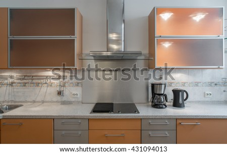 Modern kitchen unit with integrated appliances.