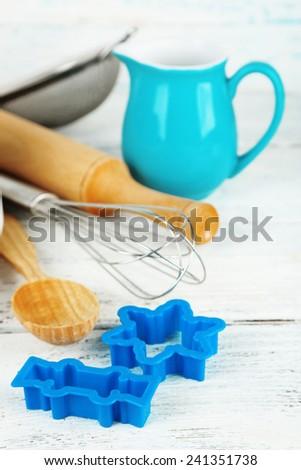 Modern kitchen utensils for baking on color wooden background - stock photo