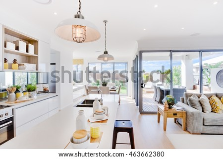 Modern Kitchen With A Dining And Patio Area Including Some Utensils On Counter Top Under The