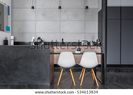 Modern Kitchen With Grey Wall Tiles, Table And Chairs