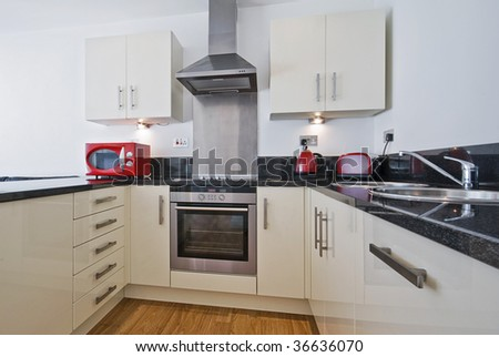 modern kitchen with trendy appliances in red - stock photo