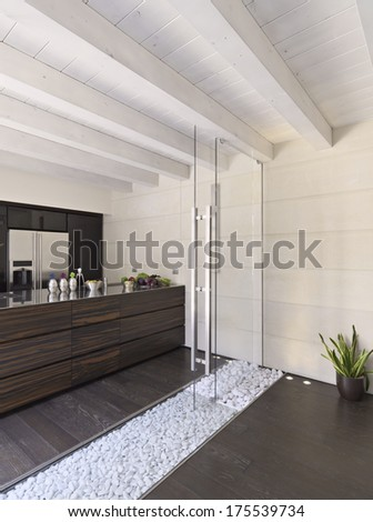 modern kitchen with wood floor and wood ceiling and glass door