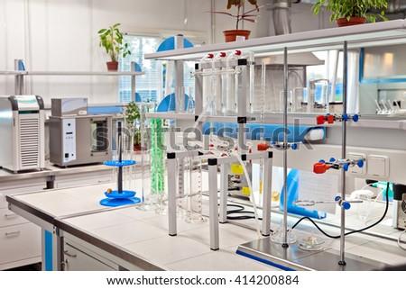 Modern laboratory interior with different lab equipment - stock photo